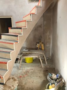Plastering for a Large Curved Concrete Staircase